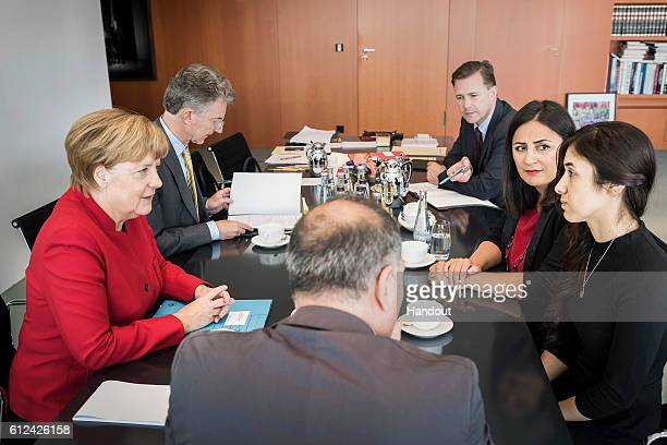In this handout photo provided by the German Government Press Office German Chanellor Angela Merkel meets human rights activist UN Goodwill...