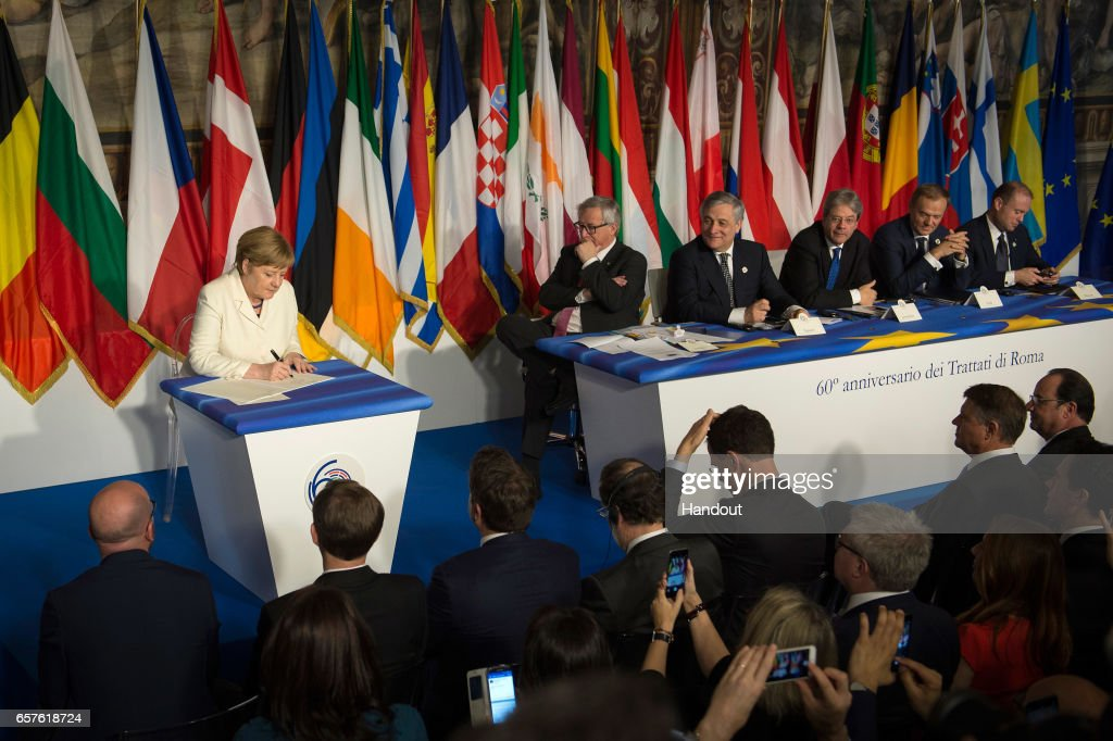 In this handout photo provided by the German Government Press Office (BPA), German Chancellor Angela Merkel signs the Rome Declaration on the occasion of the 60th anniversary of the bloc's founding Treaty of Rome on March 25, 2017 in Rome, Italy. The 60th anniversary of the signing of the treaties creating the European Economic Community and the European Atomic Energy Community the first major structural steps toward creating the European Union.
