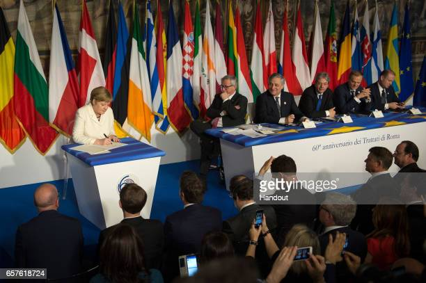 In this handout photo provided by the German Government Press Office German Chancellor Angela Merkel signs the Rome Declaration on the occasion of...