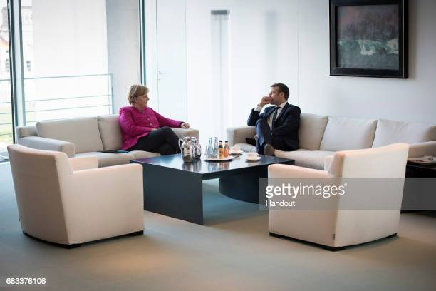 In this handout photo provided by the German Government Press Office German Chancellor Angela Merkel meets newlyelected French President Emmanuel...