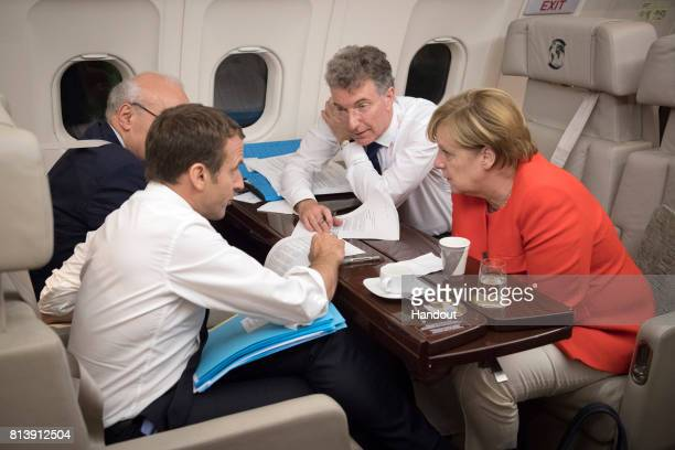 In this handout photo provided by the German Government Press Office German Chancellor Angela Merkel and the French President Emmanuel Macron are on...