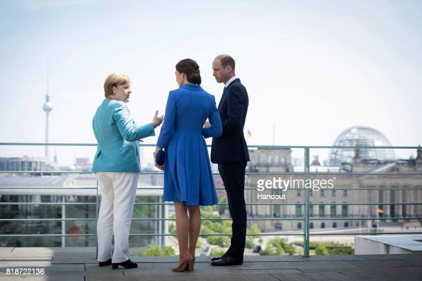 In this handout photo provided by the German Government Press Office Chancellor Angela Merkel meets Prince William Duke of Cambridge and Catherine...