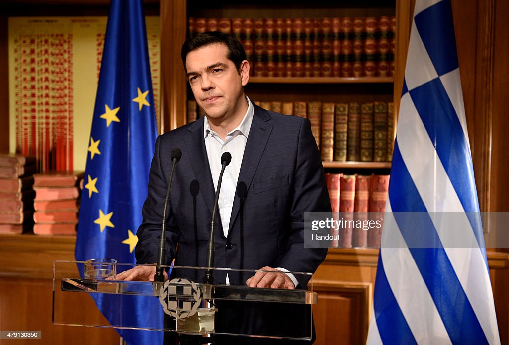 In this handout photo provided by the Greek Prime Minister's Office Greek Prime Minister Alexis Tsirpas delivers a televised address to the nation...