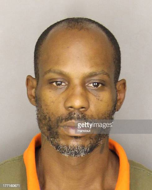 In this handout photo provided by the Greer Police Department Rapper DMX whose real name is Earl Simmons is seen in a police booking photo after his...