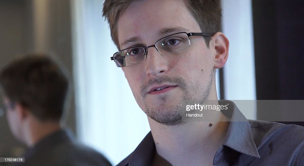 In this handout photo provided by The Guardian, <a gi-track='captionPersonalityLinkClicked' href=/galleries/search?phrase=Edward+Snowden&family=editorial&specificpeople=10983676 ng-click='$event.stopPropagation()'>Edward Snowden</a> speaks during an interview in Hong Kong. Snowden, a 29-year-old former technical assistant for the CIA, revealed details of top-secret surveillance conducted by the United States' National Security Agency regarding telecom data.