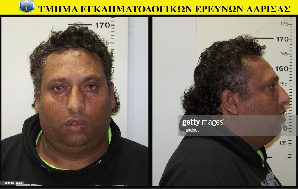 In this handout photo provided by the Hellenic Police, 39 year-old Christos Salis poses for his mugshot on October 21, 2013. The Roma couple are due to appear in court today in Larissa, Greece, on charges of abducting the young girl, who was found on Wednesday October 16th, 2013, at a Roma settlement near Farsala in central during a police raid of the area for suspected drug trafficking.