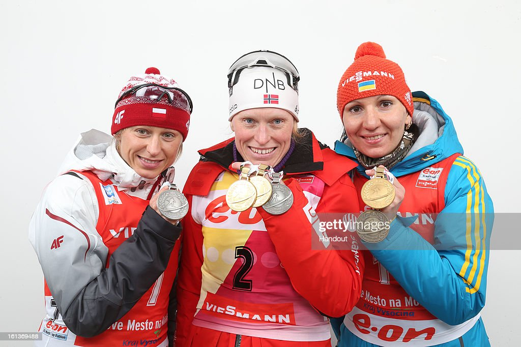 In this handout photo provided by the IBU, (L-R) Krystyna Palka of Poland, Tora Berger of Norway and Olena Pidhrushna of Ukraine hold their medals after the IBU Biathlon World Championship Women's 10km Pursuit on February 10, 2013 in Nove Mesto, Czech Republic.