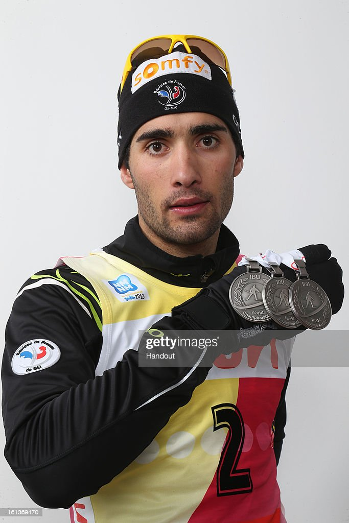 In this handout photo provided by the IBU, Martin Fourcade of France poses with his 2nd place medals after the IBU Biathlon World Championship Men's 12.5km Pursuit on February 10, 2013 in Nove Mesto, Czech Republic.
