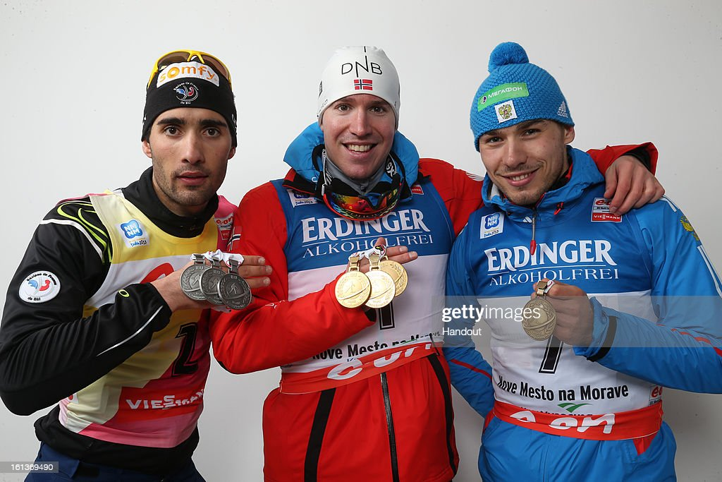 In this handout photo provided by the IBU, Martin Fourcade of France, Emil Hegle Svendsen of Norway and Anton Shipulin of Russia hold their medals after the IBU Biathlon World Championship Men's 12.5km Pursuit on February 10, 2013 in Nove Mesto, Czech Republic.