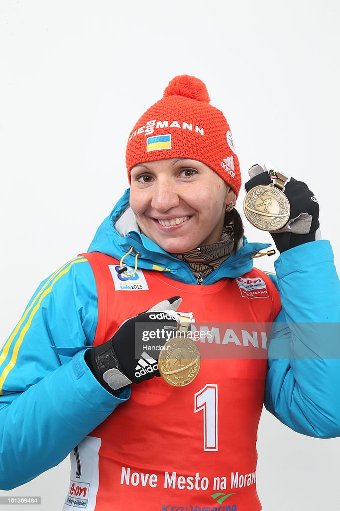 In this handout photo provided by the IBU, Olena Pidhrushna of Ukraine holds her medals after competing at the zeoring in the women's 10km pursuit event during the IBU Biathlon World Championships at Vysocina Arena on February 10, 2013 in Nove Mesto na Morave, Czech Republic.