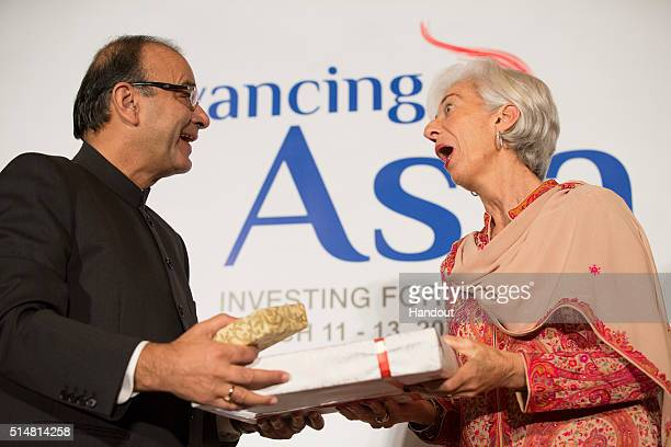 In this handout photo provided by the International Monetary Fund International Monetary Fund Managing Director Christine Lagarde exchange gifts with...