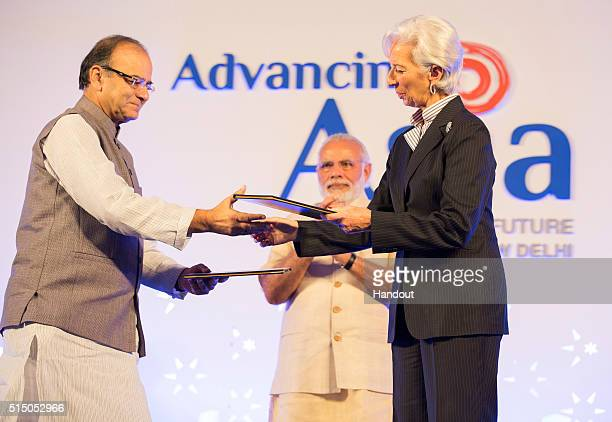 In this handout photo provided by the International Monetary Fund Prime Minister of India Narendra Modi watches as International Monetary Fund...