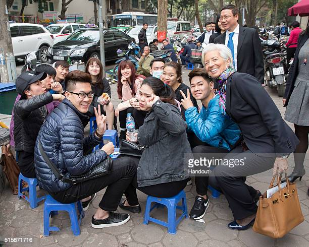In this handout photo provided by the International Monetary Fund International Monetary Fund Managing Director Christine Lagarde poses with a group...