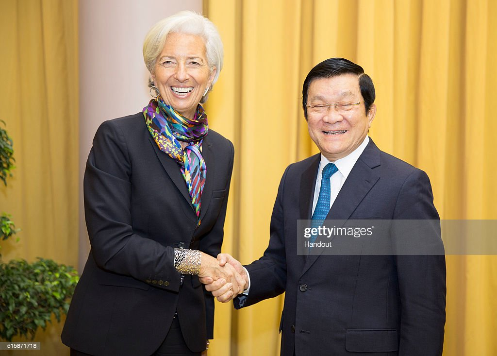 In this handout photo provided by the International Monetary Fund (IMF), International Monetary Fund Managing Director Christine Lagarde (R) is greeted by Vietnam's President Truong Tan Sang (R) at the Presidential Palace on March 16, 2016 in Hanoi, Vietnam. Lagarde is in Vietnam for three days.