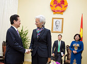 In this handout photo provided by the International Monetary Fund International Monetary Fund Managing Director Christine Lagarde is greeted by Prime...