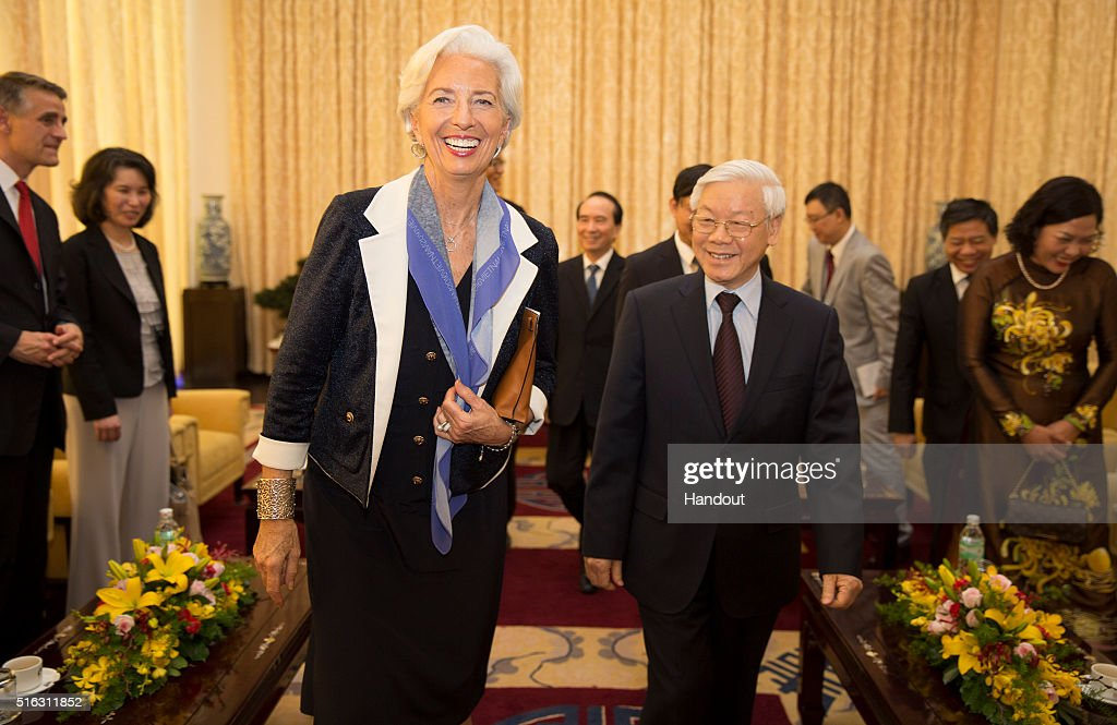 In this handout photo provided by the International Monetary Fund (IMF), International Monetary Fund Managing Director <a gi-track='captionPersonalityLinkClicked' href=/galleries/search?phrase=Christine+Lagarde&family=editorial&specificpeople=566337 ng-click='$event.stopPropagation()'>Christine Lagarde</a> laughs with General Secretary <a gi-track='captionPersonalityLinkClicked' href=/galleries/search?phrase=Nguyen+Phu+Trong&family=editorial&specificpeople=537119 ng-click='$event.stopPropagation()'>Nguyen Phu Trong</a> (R) after their meeting at the Reunification Palace on March 18, 2016 in Ho Chi Minh City, Vietnam. Lagarde is in Vietnam for three days.
