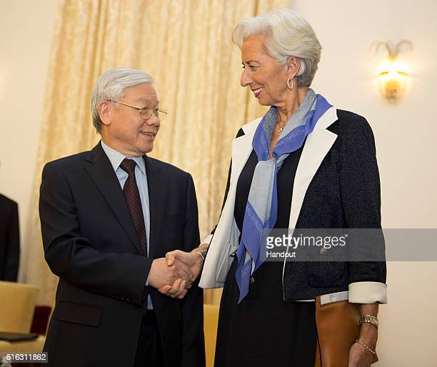 In this handout photo provided by the International Monetary Fund International Monetary Fund Managing Director Christine Lagarde shakes hands with...