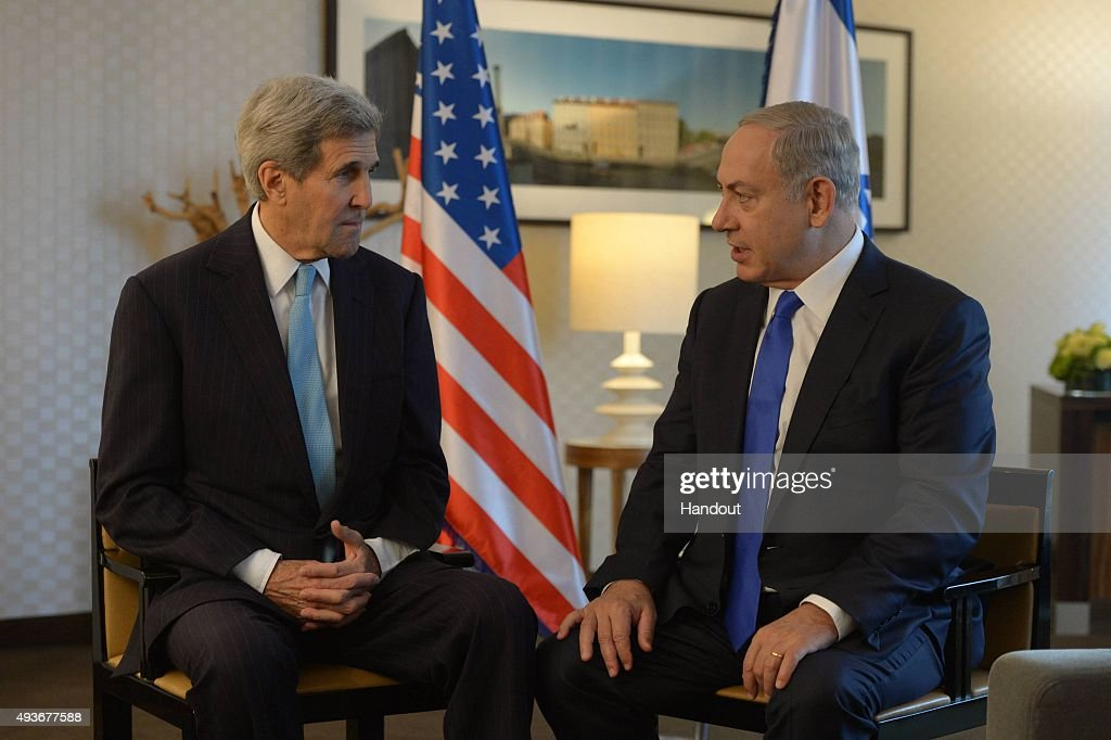 In this handout photo provided by the Israel Government Press Office Israeli Prime Minister Benjamin Netanyahu meets with US Secretary of State John...