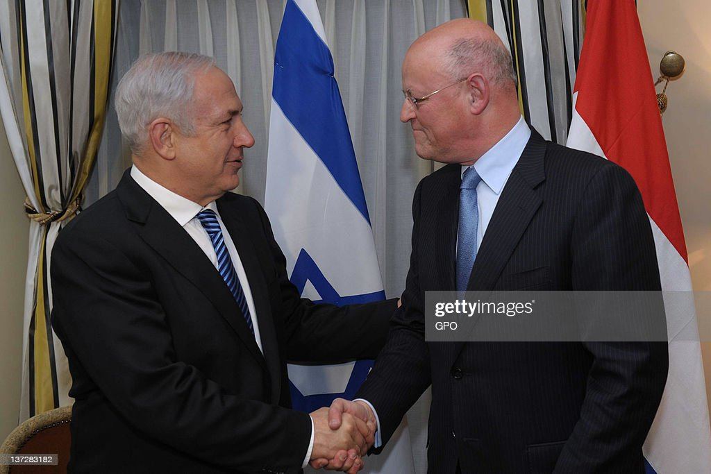 In this handout photo provided by the Israeli Government Press Office (GPO), Israeli Prime Minister <a gi-track='captionPersonalityLinkClicked' href=/galleries/search?phrase=Benjamin+Netanyahu&family=editorial&specificpeople=118594 ng-click='$event.stopPropagation()'>Benjamin Netanyahu</a> (L) meets with Dutch Foreign Minister <a gi-track='captionPersonalityLinkClicked' href=/galleries/search?phrase=Uri+Rosenthal&family=editorial&specificpeople=7052557 ng-click='$event.stopPropagation()'>Uri Rosenthal</a> January 18, 2012 in The Hague, Netherlands. Netanyahu is visiting the Netherlands for two days to strengthen relations between the two countries.