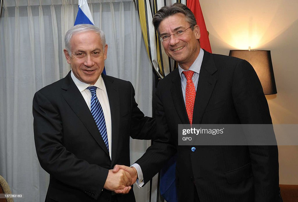 In this handout photo provided by the Israeli Government Press Office (GPO), Israeli Prime Minister <a gi-track='captionPersonalityLinkClicked' href=/galleries/search?phrase=Benjamin+Netanyahu&family=editorial&specificpeople=118594 ng-click='$event.stopPropagation()'>Benjamin Netanyahu</a> (L) meets with Dutch Deputy Prime Minister, Minister of Economic Affairs, Agriculture and Innovation <a gi-track='captionPersonalityLinkClicked' href=/galleries/search?phrase=Maxime+Verhagen&family=editorial&specificpeople=3940943 ng-click='$event.stopPropagation()'>Maxime Verhagen</a> January 18, 2012 in The Hague, Netherlands. Netanyahu is visiting the Netherlands for two days to strengthen relations between the two countries.