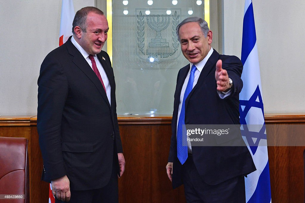In this handout photo provided by the Israeli Government Press Office, Prime Minister of Israel <a gi-track='captionPersonalityLinkClicked' href=/galleries/search?phrase=Benjamin+Netanyahu&family=editorial&specificpeople=118594 ng-click='$event.stopPropagation()'>Benjamin Netanyahu</a> (R) greets President of Georgia <a gi-track='captionPersonalityLinkClicked' href=/galleries/search?phrase=Giorgi+Margvelashvili&family=editorial&specificpeople=10916956 ng-click='$event.stopPropagation()'>Giorgi Margvelashvili</a> October 20, 2015 as they meet in Jerusalem, Israel.