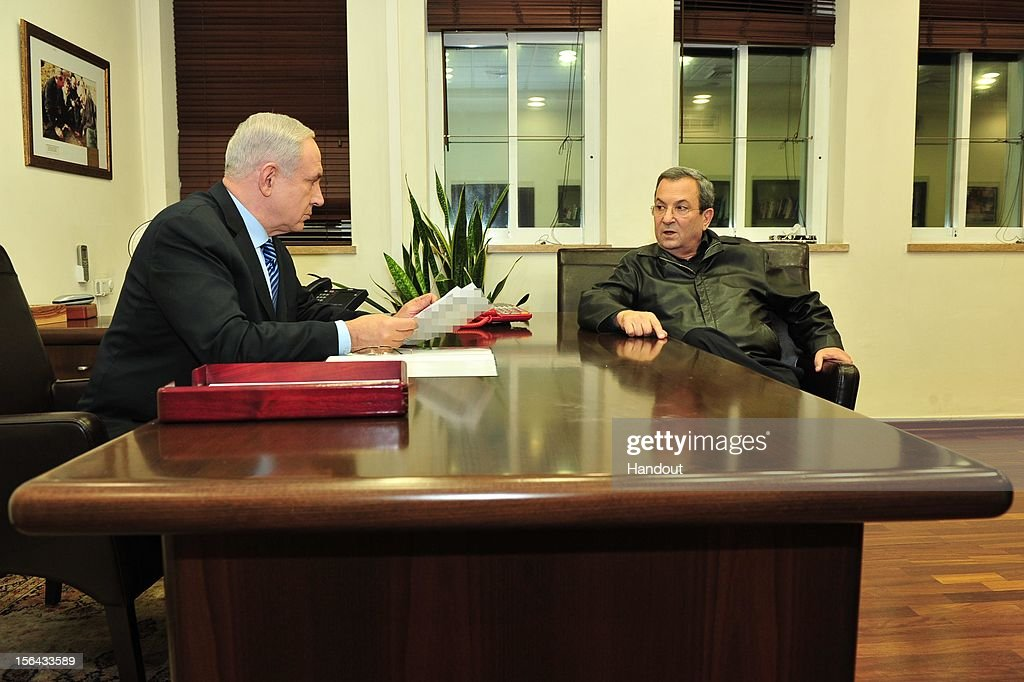 In this handout photo provided by the Israeli Ministry of Defence, Israeli Prime Minister <a gi-track='captionPersonalityLinkClicked' href=/galleries/search?phrase=Benjamin+Netanyahu&family=editorial&specificpeople=118594 ng-click='$event.stopPropagation()'>Benjamin Netanyahu</a> (L) and Defense Minister <a gi-track='captionPersonalityLinkClicked' href=/galleries/search?phrase=Ehud+Barak&family=editorial&specificpeople=202888 ng-click='$event.stopPropagation()'>Ehud Barak</a> hold talks at the Prime Minister's Office on November 14, 2012 in Kirya, Israel. Violence has escalated in the Gaza strip after Israeli forces and Palestinian militants exchanged rocket fire following the killing of Hamas's military leader Ahmed al-Jabari.