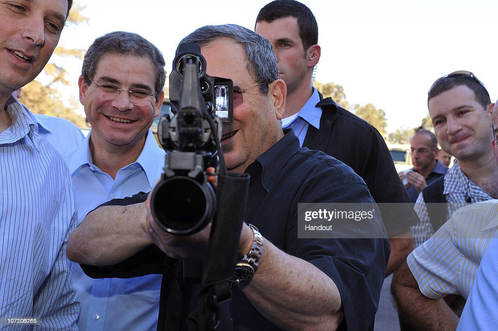 In this handout photo provided by the Israeli Ministry of Defense Israeli Defense Minister Ehud Barak visits a weapons factory on November 30 2010 in...