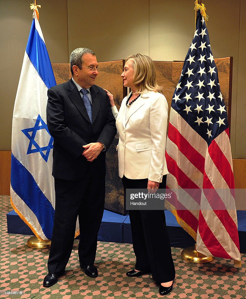 In this handout photo provided by the Israeli Ministry of Defense Israeli Defense Minister Ehud Barak attends a photocall with US Secretary of State...