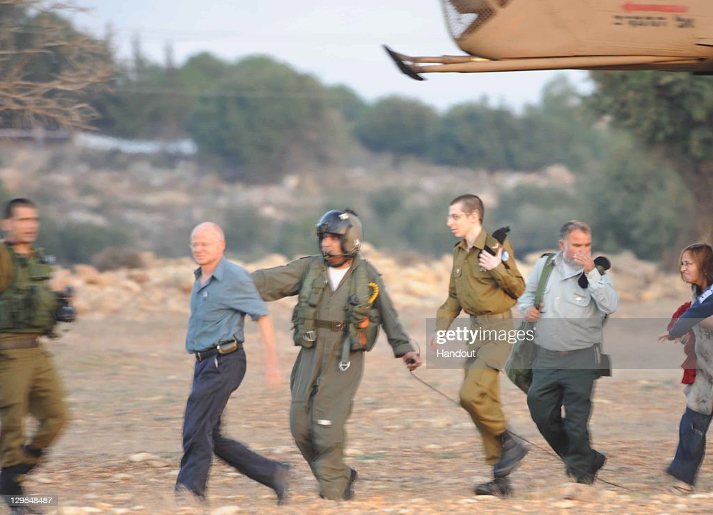 In this handout photo provided by the Israeli Police, freed Israeli soldier <a gi-track='captionPersonalityLinkClicked' href=/galleries/search?phrase=Gilad+Shalit&family=editorial&specificpeople=537101 ng-click='$event.stopPropagation()'>Gilad Shalit</a> and his father Noam arrive at their home town on October 18, 2011 in Mitzpe Hila, Israel. Shalit was freed after being held captive for five years in Gaza by Hamas militants, in a deal which saw Israel releasing more than 1,000 Palestinian prisoners.