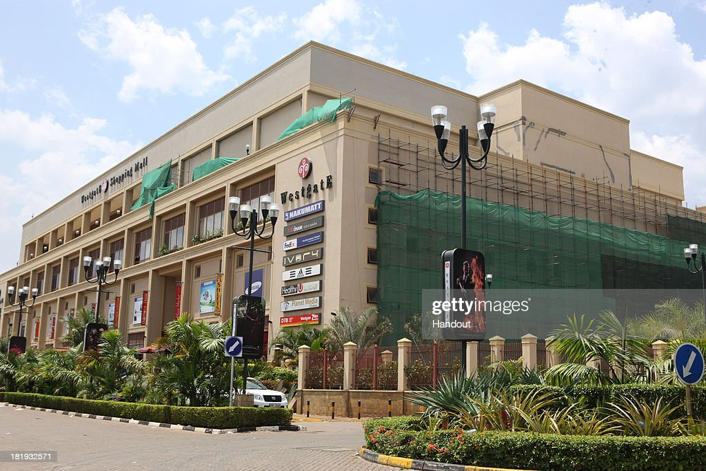 In this handout photo provided by the Kenyan Presidential Press Service Cars are parked outside the Westgate Mall on September 26 2013 in Nairobi...