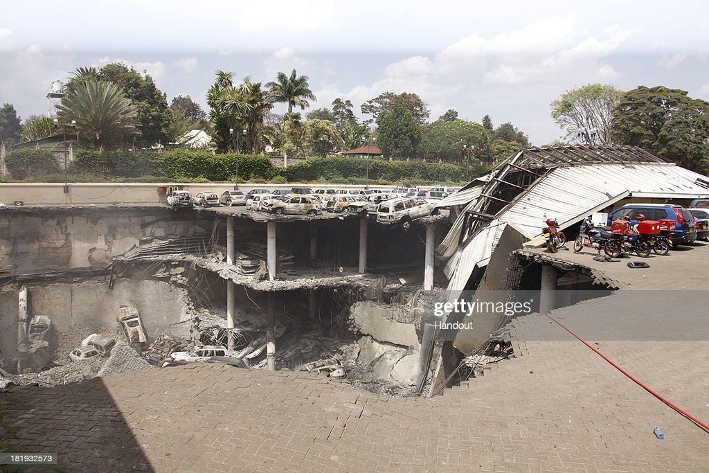 In this handout photo provided by the Kenyan Presidential Press Service, The remains of cars and other debris can be seen in a general view photographed from the rooftop of the parking lot outside the Westgate Mall on September 26, 2013 in Nairobi, Kenya. The country is observing three days of national mourning as security forces begin the task of clearing and securing the Westgate shopping mall following a four-day siege by militants.