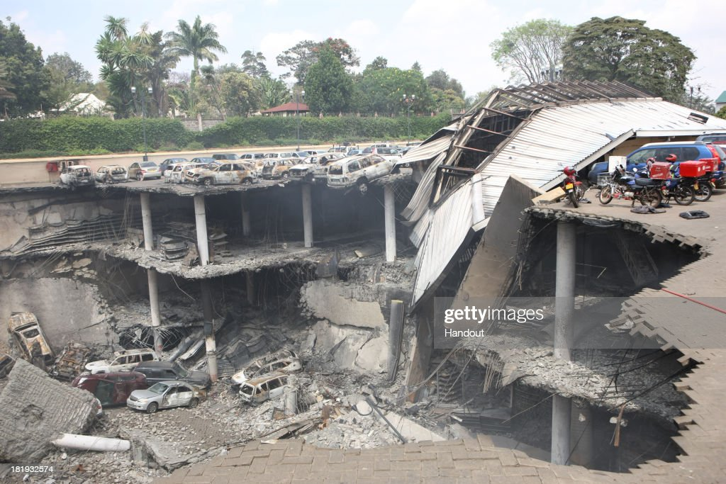 In this handout photo provided by the Kenyan Presidential Press Service, The remains of cars and other debris can be seen in a general view photographed from the rooftop, of the parking lot outside the Westgate Mall on September 26, 2013 in Nairobi, Kenya. The country is observing three days of national mourning as security forces begin the task of clearing and securing the Westgate shopping mall following a four-day siege by militants.