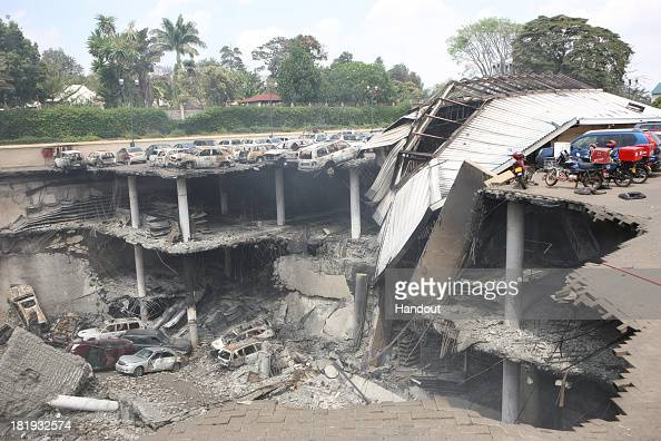 In this handout photo provided by the Kenyan Presidential Press Service The remains of cars and other debris can be seen in a general view...