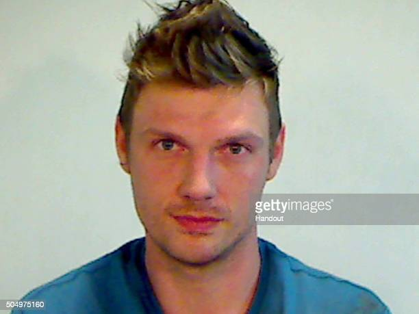 In this handout photo provided by the Key West Police Department singer Nick Carter of the Backstreet Boys is seen in a police booking photo after...