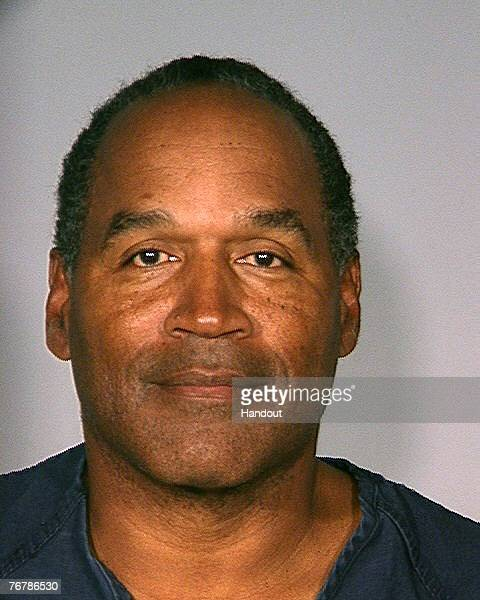 In this handout photo provided by the Las Vegas Police Department former football player OJ Simpson poses for a mugshot photo September 16 2007 in...