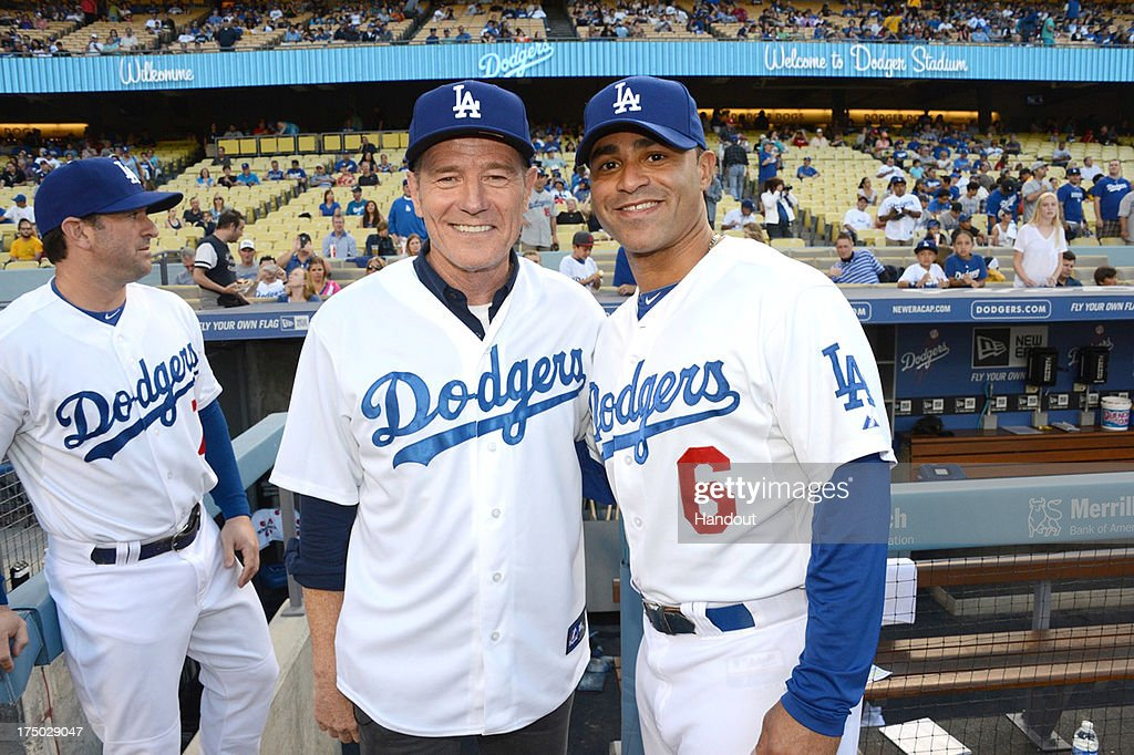 In this handout photo provided by the Los Angeles Dodgers, <a gi-track='captionPersonalityLinkClicked' href=/galleries/search?phrase=Bryan+Cranston&family=editorial&specificpeople=217768 ng-click='$event.stopPropagation()'>Bryan Cranston</a> and Jerry Hairston, Jr. attend the Cincinnatti Reds versus Los Angeles Dodgers game at Dodger Stadium on July 26, 2013 in Los Angeles, California.