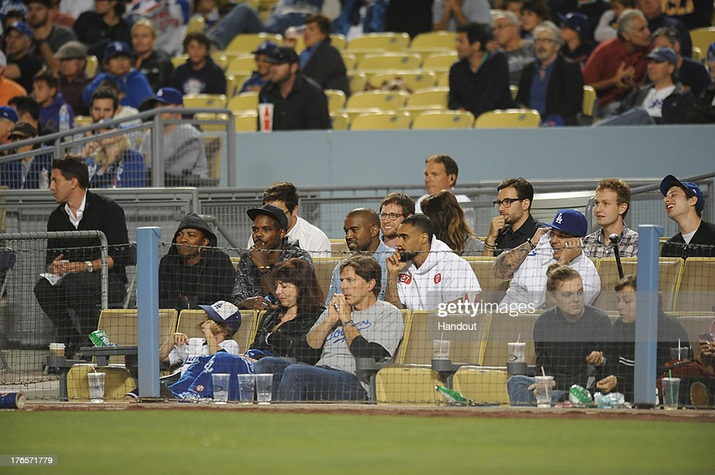In this handout photo provided by the Los Angeles Dodgers, Kanye West and Rob Kardashian attend the New York Mets v Los Angeles Dodgers game at Dodger Stadium on August 14, 2013 in Los Angeles, California.