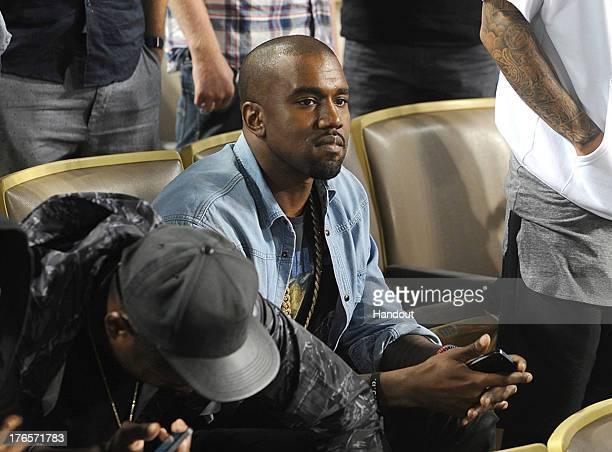 In this handout photo provided by the Los Angeles Dodgers Kanye West attends the New York Mets v Los Angeles Dodgers game at Dodger Stadium on August...