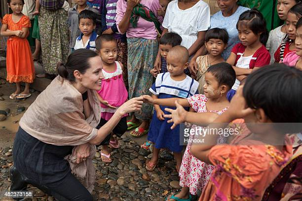 In this handout photo provided by the Maddox JoliePitt Foundation actress and activist Angelina Jolie Pitt meets children during a visit to Ja Mai...