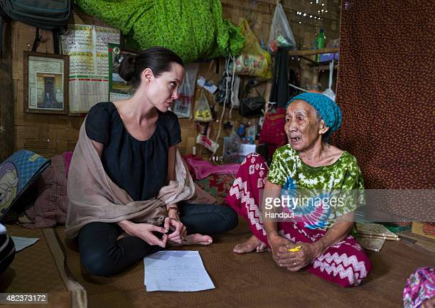 In this handout photo provided by the Maddox JoliePitt Foundation actress and activist Angelina Jolie Pitt meets meets a 90 year old woman during a...