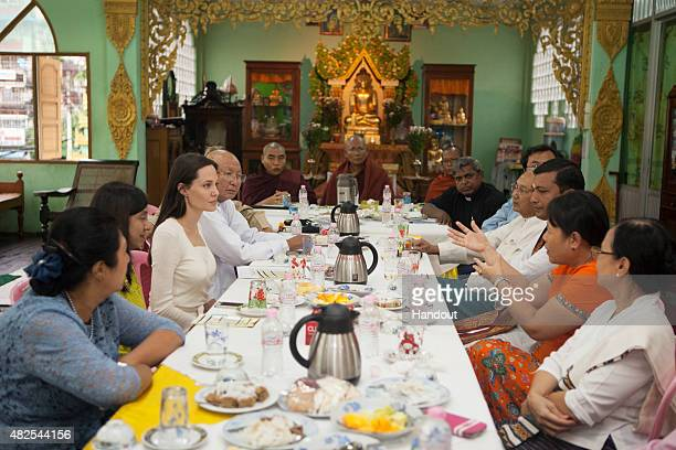 In this handout photo provided by the Maddox JoliePitt Foundation actress and activist Angelina Jolie Pitt visits the Phayar Pyu Monastery on July 31...