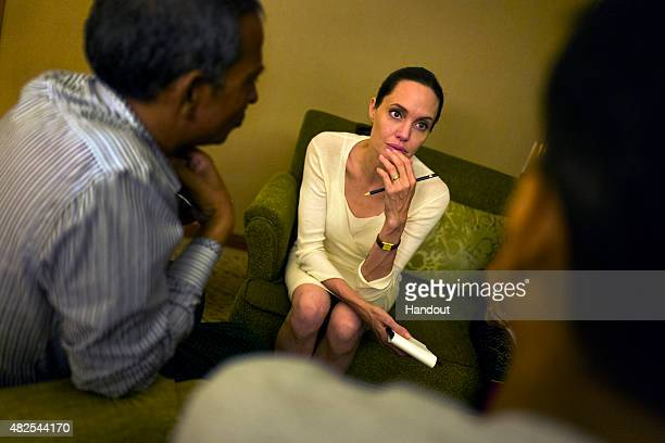 In this handout photo provided by the Maddox JoliePitt Foundation actress and activist Angelina Jolie Pitt listens to Rohingya community...