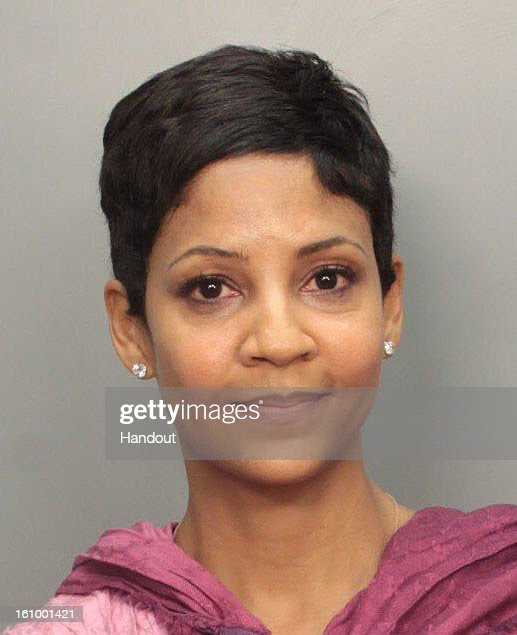 In this handout photo provided by the Miami-Dade Police Department, Tracy Wilson Mourning, businesswoman and wife of former Miami Heat Alonzo Mourning, is seen in a police booking photo after her arrest for suspicion of driving under the influence of alcohol in the early morning hours of February 8, 2013 in Coral Gables, Florida.