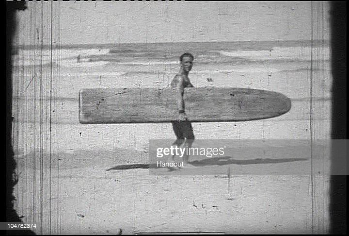 In this handout photo provided by the Museum of British Surfing, The earliest image so far of a surfer in Britain with a full size 'stand-up' surfboard c1929 Lewis Rosenberg is seen on October 4, 2010 in Braunton, England. The Museum of British Surfing, a charity which originally started online, has been touring the UK since 2004 and is Europe's first surf museum. It holds the largest surfboard collection in Britain and has secured funding for a permanent home, which will open in Braunton next summer. As well as the collection of surfboards dating back over 100 years, the museum also holds early wetsuits, photos and other memorabilia relating to the phenomenal growth in the popularity of surfing. Although many people assume surfing in the UK began in the 1960s, the museum contains evidence that show that it was in fact already a mass participant activity on British beaches by the end of the First World War. Surfing is now a multi-million pound industry and employs 1000s of people in the UK. (Photo from the collection of the Museum of British Surfing - www.museumofbritishsurfing.org.uk via Getty Images) For use with Surf Museum feature only. Mandatory credit should read 'From the collection of the Museum of British Surfing - www.museumofbritishsurfing.org.uk'