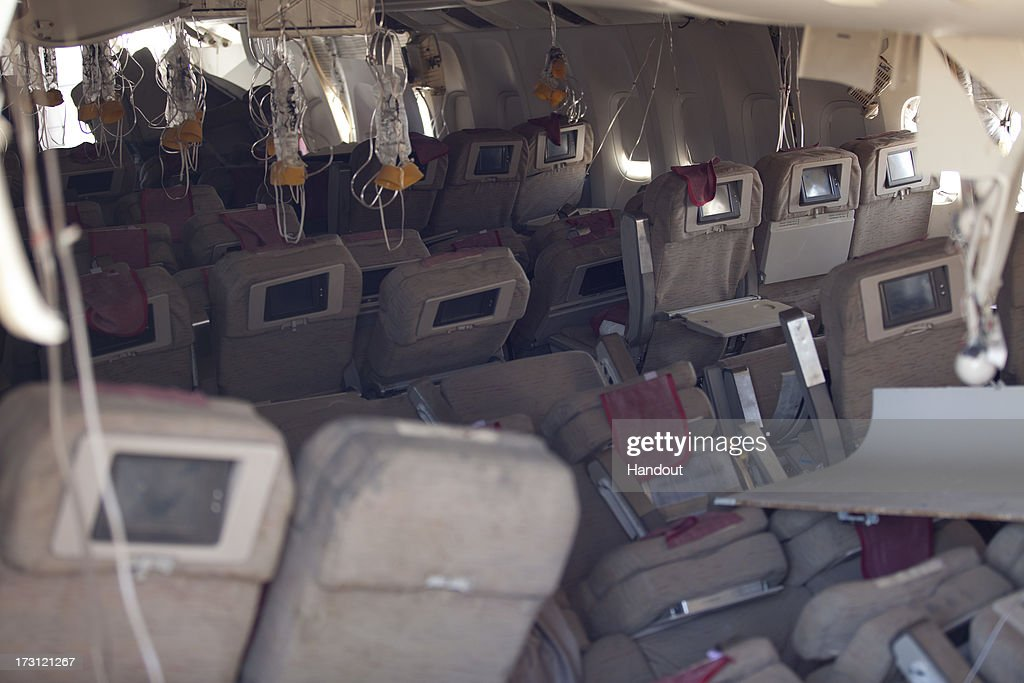 In this handout photo provided by the National Transportation Safety Board, oxygen masks hang from the ceiling in the cabin interior of Asiana Airlines flight 214 following yesterday's crash, on July 7, 2013 in San Francisco, California. The Boeing 777 passenger aircraft from Asiana Airlines coming from Seoul, South Korea crashed landed on the runway at San Francisco International Airport. Two people died and dozens were injured in the crash.