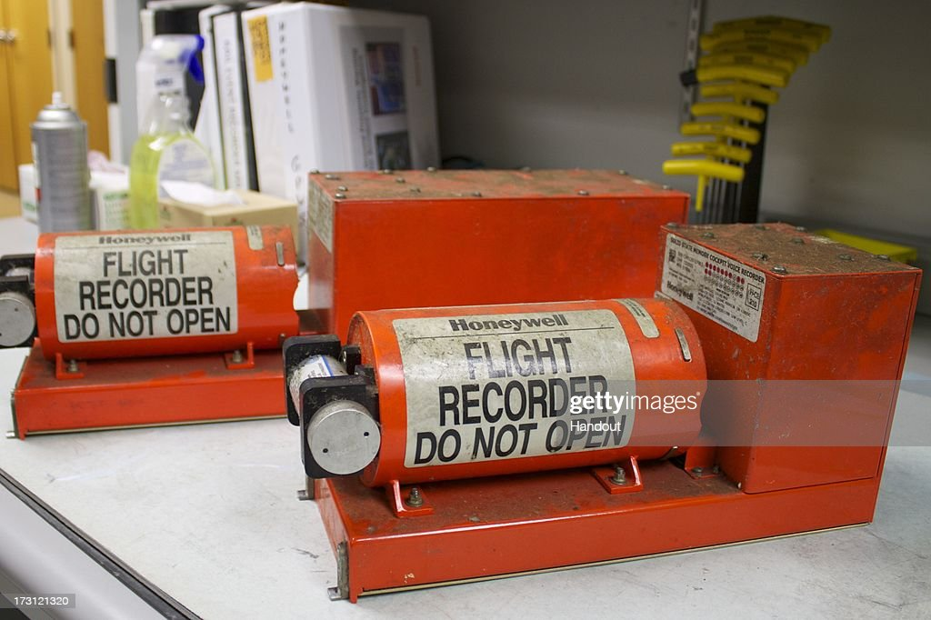 In this handout photo provided by the National Transportation Safety Board, the Asiana Airlines flight 214 flight data recorder (L) and the cockpit voice recorder (R) are displayed in the NTSB's laboratory on July 7, 2013 in Washington, DC. The Boeing 777 passenger aircraft from Asiana Airlines coming from Seoul, South Korea crashed landed on the runway at San Francisco International Airport. Two people died and dozens were injured in the crash.