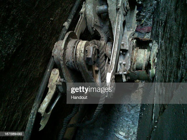 In this handout photo provided by the New York City Police Department, an apparent part of the landing gear from one of the commercial planes used in the September 11 attacks sits between two buildings in lower Manhattan on April 26, 2013 in New York City. The area is being processed as a crime scene and will not be removed until the process is complete.