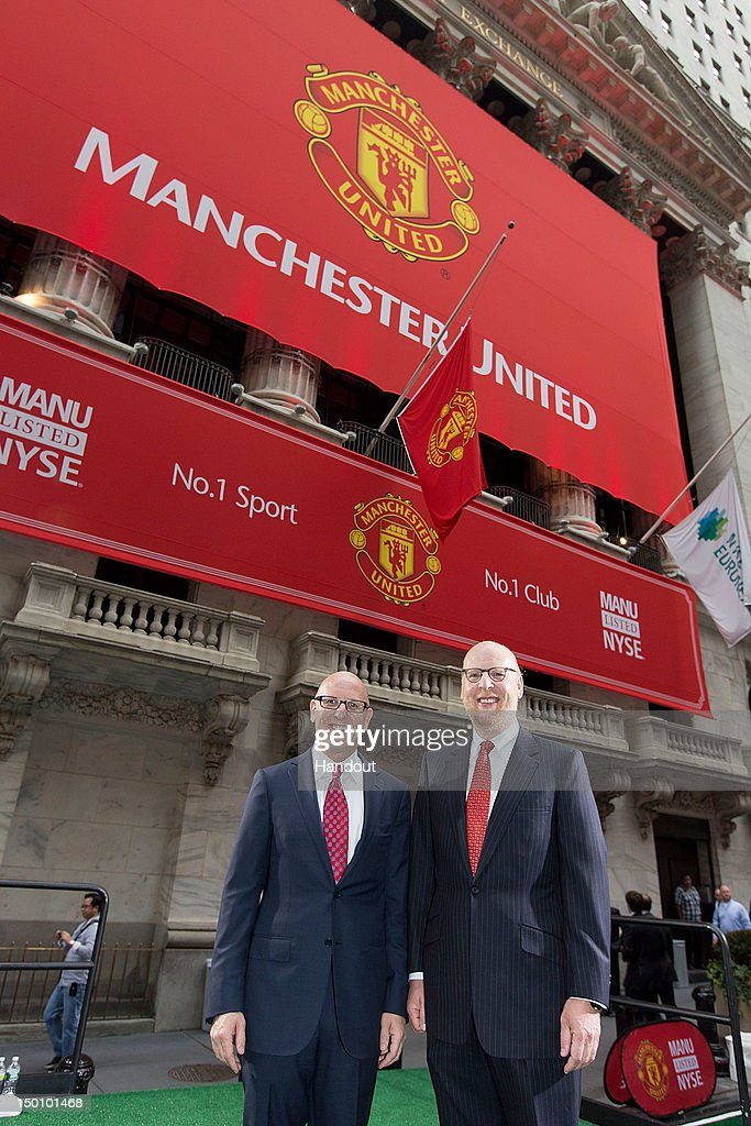 In this handout photo provided by the NYSE Euronext, Manchester United Executives Joel Glazer (L) and Avram Glazer prepare to ring the Opening Bell at the New York Stock Exchange on August 10, 2012 in New York City. Manchester United shares started trading at USD 14.05 at the opening of the New York Stock Exchange.