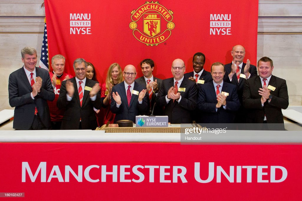 In this handout photo provided by the NYSE Euronext, Manchester United Executives David Gill (L), Joel Glazer (3rd L) and Avram Glazer (4th L) and Ed Woodward prepare to ring the Opening Bell at the New York Stock Exchange on August 10, 2012 in New York City. Manchester United shares started trading at USD 14.05 at the opening of the New York Stock Exchange.