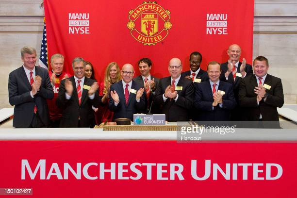 In this handout photo provided by the NYSE Euronext Manchester United Executives David Gill Joel Glazer and Avram Glazer and Ed Woodward prepare to...
